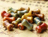 50 pzas 18 mm * 10 mm, tamaño de agujero de aproximadamente 1.5 mm Perlas de porcelana en forma de hueso, color mixto forma plana redonda, bricolaje de cerámica perlas sueltas joyas hallazgo