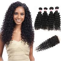 9A Peruvian Malaysian Indian Mongolian Brazilian Bundles de cheveux vierges avec fermeture Deep Wave / Kinky cheveux bouclés bouclés avec fermeture à lacets
