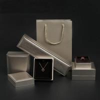 Top Bottom Schmuck Geschenk Verpackungsbox Hohe Qualität Schmuck Ring Anhänger Halskette Armreif Armband Display Boxen mit Papiertüte anpassen