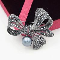 Spilla Big Bow stile vintage nero Perla simulata e strass nero Perno broccia stupefacente Pin per donna delicato Hijab Wear