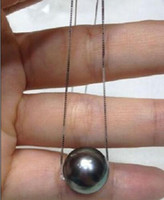 10-11mm Natural Round Tahitian Black Pearl Pendant in White collana in argento