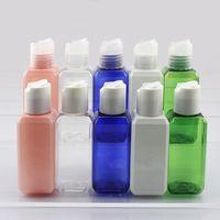 100pcs 50ml botellas blancas plásticas claras azules verdes rosadas con las tapas superiores del disco, envases de la loción BPA liberan la botella líquida rellenable del jabón