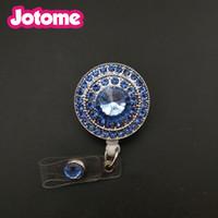 Portamonete a forma di anello con bottone rotondo in strass