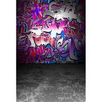 Fondali colorati di fotografia di arte dei graffiti hanno stampato il fondo grigio dello studio della foto dei bambini del pavimento di struttura di calcestruzzo concreto dei bambini