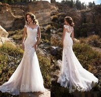 Sheer V- Neck Appliqued Lace Wedding Dresses Sweep Train Merm...