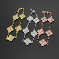 Venta al por mayor Cinco flores de cuatro hojas flores cielo lleno estrella CZ pulsera brazaletes para las mujeres marca moda encantos regalo de la joyería