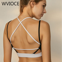 91f7d33718 New Arrival. Sexy Yoga Bra Women Padded Back Cross Strap Sports Bra  Black White Patchwork Running Workout Gym Tank Top Fitness Quick Dry Vest