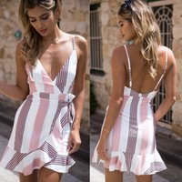 Femmes Floral Robe d'été Mini Summer Party Party Beach Dress Élégant Floral col en V Backless Sexy robe de plage bohème Femme