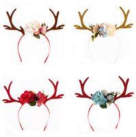 Fascia natalizia Elk Deer Antlers Ear Hair Hoop con fiori Antlers Costume Ear Party Fascia per capelli Floral Hairband