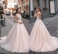 Encantadora novia Una línea Vestidos de novia Ilusión Blusa Apliques de encaje Vestidos de novia largos de tul Barrer tren