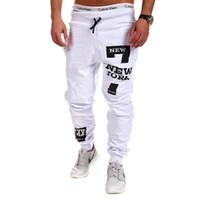 Nuevos pantalones rectos casuales para hombres Pantalones de entrenamiento de fitness de algodón de rendimiento Pantalones de chándal casuales Pantalones Pantalones de chándal Ropa para el hogar