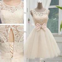 Nouvelle arrivée courte dentelle de champagne une ligne robes de mariée bijou sans manches illusion chérie lacets jupes en tulle robes de mariée