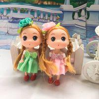 12 pçs / lote Novos Brinquedos Infantis Macio Interativo Baby Dolls Mini Boneca pingente Para Meninas meninos aniversário presente de Natal bom preço frete grátis