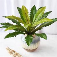하나의 인공 잎 잔뜩 가짜 큰 녹색 잎 식물 꽃꽂이 부분 녹지 벽 장식을위한 여러 가지 디자인
