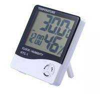 محطة الطقس الرقمية داخلي الرقمية C / F ميزان الحرارة الرطوبة على مدار الساعة مكتب شاشات الكريستال السائل الرطوبة متر مراقب HTC-1