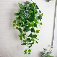 Décoration murale artificielle Verdure Faux Plante Feuille De Lierre Plastique Garland Vigne Fleurs artificielles Faux Mur De Feuillage Suspendus Plantes Vertes De Vert