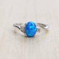 Simple Mode Classique Tendance Colorée Big Ovale Forme Oeuf Bleu Fire Opal Anneau Cubic Zircon Engagement Anneaux de mariage pour femmes