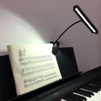 新しい柔軟な9つのLEDのマイティブライトクリップオンオーケストラピアノの音楽スタンドLEDライトテーブル読書ランプDHLフェデックスEMS送料無料