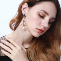 New imitation pearl earrings Female fashion pop golden jewel...