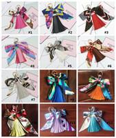 12 farben kreative bowknot blume quaste schlüsselbund autoschlüssel ring tasche anhänger erhältlich material superman schlüsselbund rucksack zubehör mk667