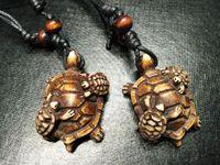 Darmowa Wysyłka YQTDmy Hurtownie 12 sztuk / partia Mężczyźni Kobiet Imitacja Yak Bone Rzeźbione Matka Dzieci Turtle Rock Naszyjnik