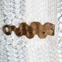 Cinta en extensiones de cabello humano de la Virgen 40 piezas Cinta de pelo de la máquina de la onda del cuerpo 100pcs Cinta en ninguna Remy Adhesivo de cabello humano Extensión