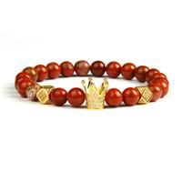 Perle di pietra rossa naturale all'ingrosso 10pcs / lot 8mm dei monili dell'oro con i braccialetti di fascini della parte superiore pavimentati micro di alta qualità per il regalo