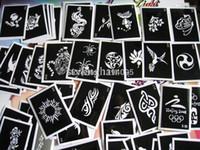 Stencil del tatuaggio misto all'ingrosso 100pcs / lot per la pittura delle immagini del tatuaggio del hennè progetta lo stencil riutilizzabile del tatuaggio dell'aerografo