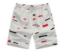 Sommer-Strand-beiläufige Kurzschluss-elastische Taillen-Druck-Mens-aktive Sportkleidung-dünne Art- und Weisehosen-gerade Mehrfarbenmänner schließen Strand-Abnutzung kurz