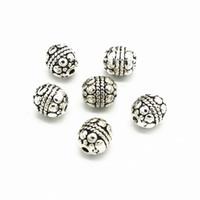 Perlas del espaciador de la aleación del metal de la vendimia de 100 PCS 7mm * 8mm Perlas talladas Nepal del agujero para la fabricación de la joyería