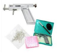 CHEGADA NOVA Professional Ouvido, Nariz Body Piercing Gun Machine Tool Kit Set + 98Pcs Aço Studs Piercing Orelha armas Ferro Suit frete grátis