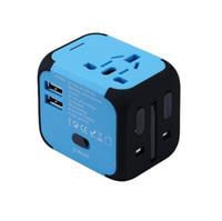 Nuevo convertidor universal de los enchufes de los enchufes del enchufe del viaje de los EEUU / AU / UK / EU con el USB dual que carga el indicador de poder de 2.4A LED