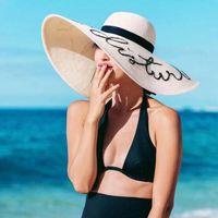 Donne pieghevoli floppy lettere sequin ricamo ricamo cappello da sole estate estate selvaggia grande bordo con nastro trim beach cap uv protezione UV
