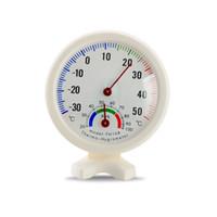 Venta al por mayor forma redonda Mini blanco interior exterior analógico centígrado Dial termómetro higrómetro temperatura humedad medidor wen6755