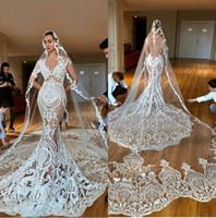 Underbara sjöjungfrubröllopsklänningar Ärmlös V Neck Lace Brudklänningar Täckt Knapp Tillbaka Plus Storlek Saudiarabiska Dubai Vestido de Novia