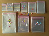 100pcs / lot4x6cm / 5x7cm / 6x8cm / 7x9cm / 5x10cm / 6x10cm / 7x12cm / 6x12cm / 8x12cm auto-adhésif Seal OPP sac de rangement Emballage