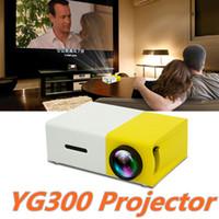 YG300 LED المحمولة العارض 400-600LM الصوت 3.5mm 320 × 240 بكسل YG300 USB ميني بروجكتور الرئيسية ميديا بلاير دي إتش إل الحرة