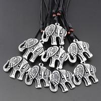 JOYERÍA Al Por Mayor 12 unids Imitación Yak Bone Tallado Tibetano Afortunado Elefante Blanco Collar Colgante Amuleto Regalos para hombres mujeres MN150
