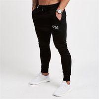 2018 Nuevos Pantalones para hombre Gimnasios Pantalones de chándal para  hombre Culturismo Culturismo Casual Elástico de daab02062e0