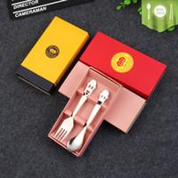 Diseño único ¡Juego de regalo promocional! Caja de embalaje colorido de la caja Cara sonriente Juego de cuchara y tenedor de acero inoxidable Set de cuchara de plata