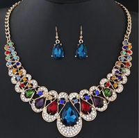 ファッションクリスタル結婚式のジュエリーセットの女性の花嫁のパーティージュエリーの高級インドのブライダルネックレスイヤリングは安い