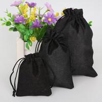 Borse decorative dei monili di cerimonia nuziale del cotone di lino nero 5pcs Borse di imballaggio del prodotto della borsa di Natale / sacchetti del regalo di nozze