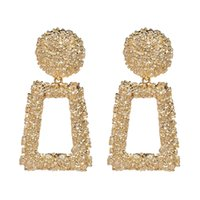 2018 New Geometric- shaped golden earrings featuring a raised...