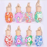 I più popolari ricaricabili portatile corda Piccolo Hang bottiglia vuota 15ml auto decorazione appesa essenza ceramica Bottiglie di profumo di olio
