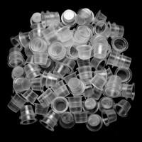 1000ピースの中サイズのタトゥーインクカップキャップ供給専門の永久的な入れ墨のタトゥー機のプラスチック専門職の色カップ