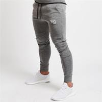 1eb27e382c4f6 2018 New VQ Gyms roupas em homens calças homens moda Jogger Calças calça  casual Skinny top