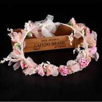 Flores, heno, coronas, novias, vestidos, ferias, cabezas rosas, cintas para el cabello.