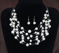 2019 Nuevos conjuntos de joyas nupciales de oro Pendientes Perlas de cuello Joyas nupciales Conjuntos de pendientes de collar de plata para mujeres Regalo de boda de moda