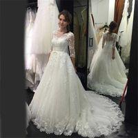 Lange Ärmel Elegante Spitze Brautkleider Sheer Hals bescheidene Brautkleid Land Brautkleider mit Knöpfen Vestido de Noiva