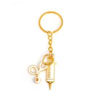 Spritzen-Stethoskop Keychain 2 Arten Metallgold medizinische Versorgungsmaterialien Schlüsselring-Schlüsselkette für Doktoren Krankenschwester-Schmuck-Abschluss-Geschenk
